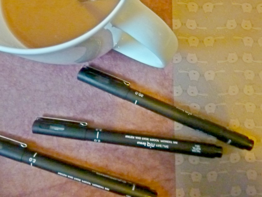 Coffee and pens
